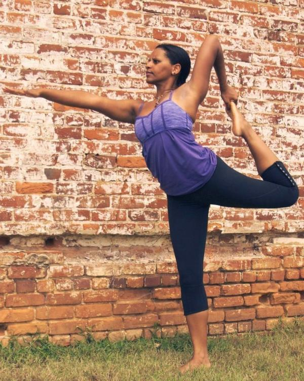 Yoga instructor Dara Brown stretches — and stretches her students, too.