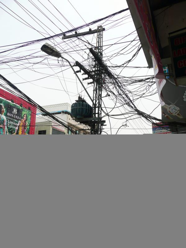 Tangled power lines in a busy shopping district in Rawalpindi.