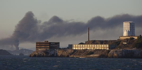 Smoke poured from the fire at a Chevron refinery in Richmond, Calif. Here, the plume rises behind Alcatraz Island in San Francisco.