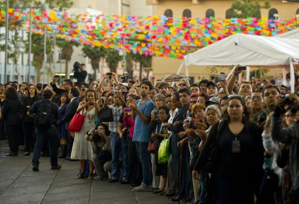 Fans wait to see the coffin of late Costa Rican-born Mexican singer Chavela Vargas during a ceremony in her honour at Garibaldi Square in Mexico City on Monday.