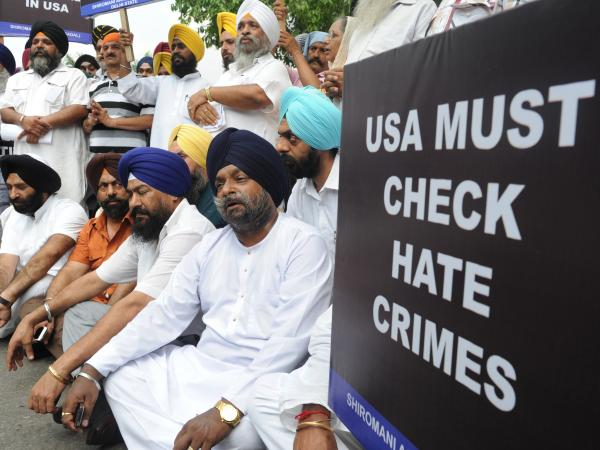 Activists protest near the U.S. Embassy in New Delhi after a gunman shot worshipers at a Sikh temple in Wisconsin on Sunday.
