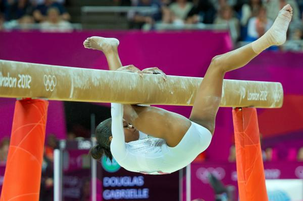 U.S. gymnast Gabrielle Douglas falls off the balance beam during the finals. Douglas finished in seventh place.
