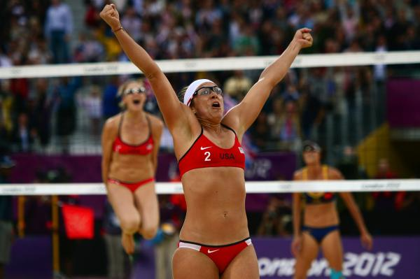 Misty May-Treanor of the U.S. celebrates at the end of the women's beach volleyball semifinal with Kerri Walsh Jennings (in the background) against China's Xue Chen and Zhang Xi.