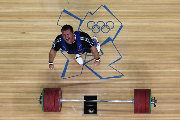Ruslan Albegov of Russia reacts after completing one of his lifts during the men's 105kg weightlifting final. He finished third in the event.