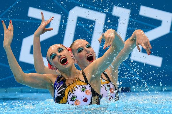 Russia's Natalia Ishchenko and Svetlana Romashina compete in the duets free routine final during the synchronized swimming competition. The pair won the event.