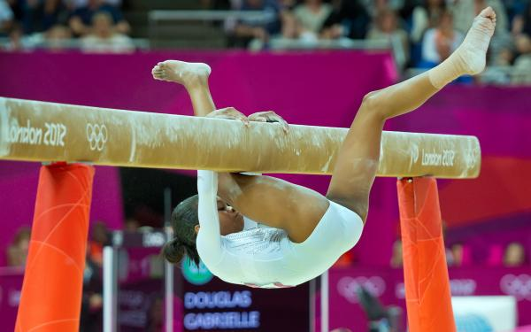 U.S. gymnast Gabrielle Douglas falls off the balance beam during the individual event finals, finishing in seventh place.