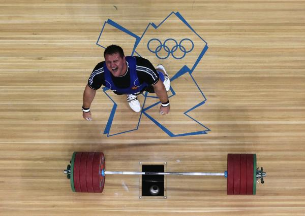 Ruslan Albegov of Russia reacts after completing one of his lifts during the men's 105-kilogram weightlifting final. He finished third in the event.