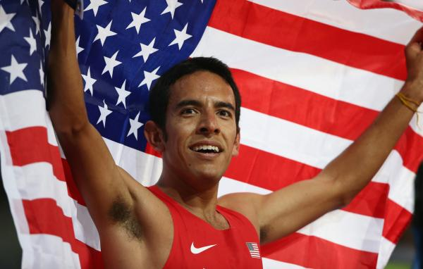 Leonel Manzano of the United States celebrates after winning silver in the Men's 1500m Final at Olympic Stadium in London.