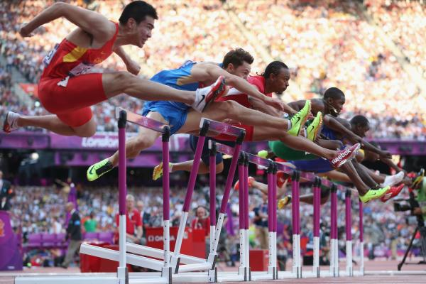 Wenjun Xie of China (left), Konstantin Shabanov of Russia, Aries Merritt of the U.S., Andrew Turner of Great Britain and Selim Nurudeen of Nigeria compete in the men's 110-meter hurdles semifinal.