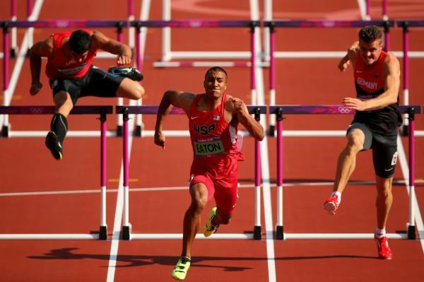 Gonzalo Barroilhet of Chile (left), Ashton Eaton of the U.S. and Rico Freimuth of Germany compete during a men's decathlon 110-meter hurdles heat. Eaton won the gold medal for the decathlon.