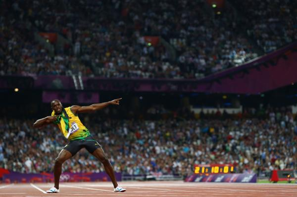 Usain Bolt of Jamaica celebrates after winning gold in the men's 200-meter final at the 2012 Summer Olympics in London.