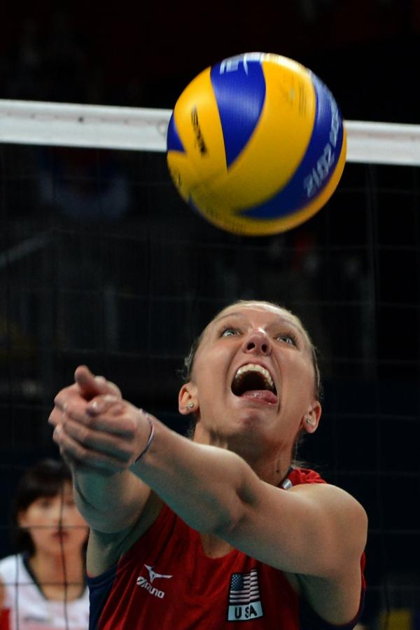 Jordan Larson of the U.S. attempts to set during the women's semifinal volleyball match against South Korea.