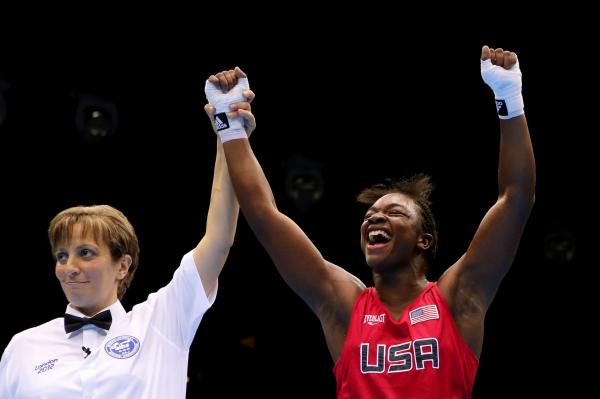 Referee Kheira Sidi Yakoub announces American Claressa Shields the winner over Nadezda Torlopova of Russia after the women's middleweight boxing final.