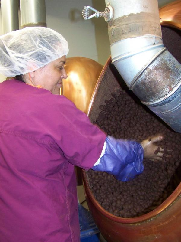 Lupe Lopez ensures a batch of Chukar's Cabernet Cherries are evenly coated with chocolate.