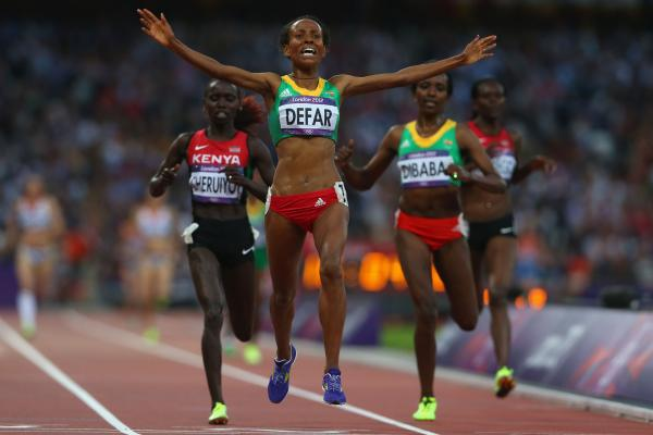 Meseret Defar of Ethiopia celebrates winning gold in the women's 5,000 meters.