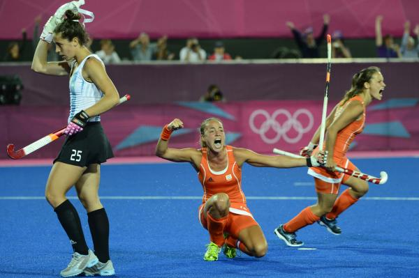 Maartje Paumen (center) of the Netherlands celebrates after a goal during the women's field hockey final against Argentina.