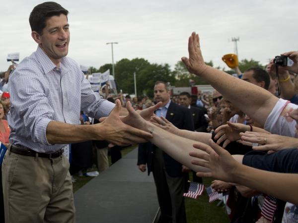 Rep. Paul Ryan, who has been chosen by Mitt Romney to be his running mate on the GOP ticket, greeting supporters Sunday in his home state of Wisconsin. Ryan will be in Iowa today.