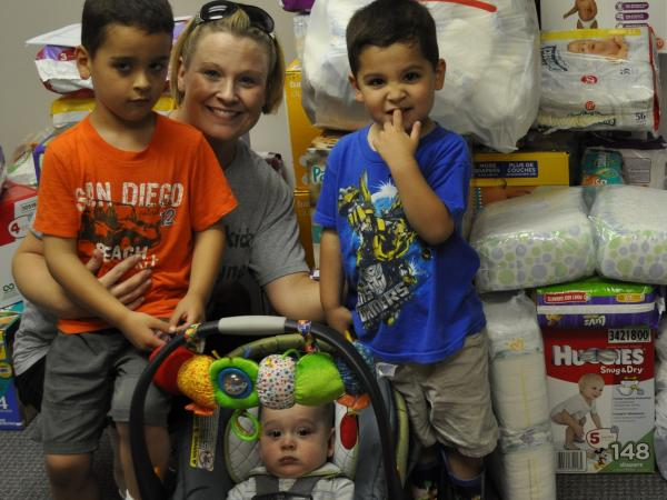 Kerry Rodriguez and her three sons organized a diaper drive for HappyBottoms at their church.