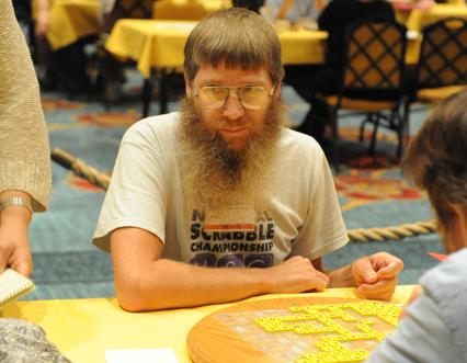 Four-time National Champion Nigel Richards. He won again today, becoming the first person to win four National Scrabble Championships and the first to win three titles in a row. A younger player, though, was caught cheating.