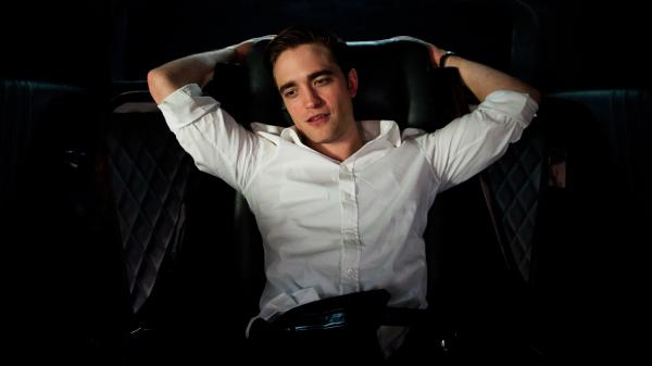 Robert Pattinson's weird, inhuman beauty is used to full effect as billionaire Eric Packer in David Cronenberg's <em>Cosmopolis</em>.