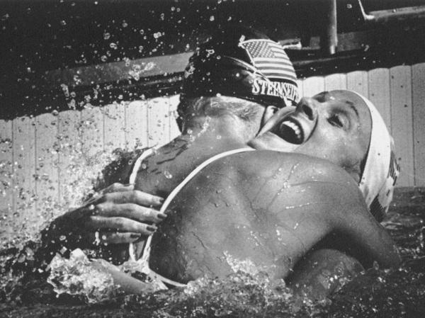 American swimmer Carrie Steinseifer, left, hugs Nancy Hogshead after they tied for the gold medal in the 100 meter freestyle competition during the 1984 Olympics.