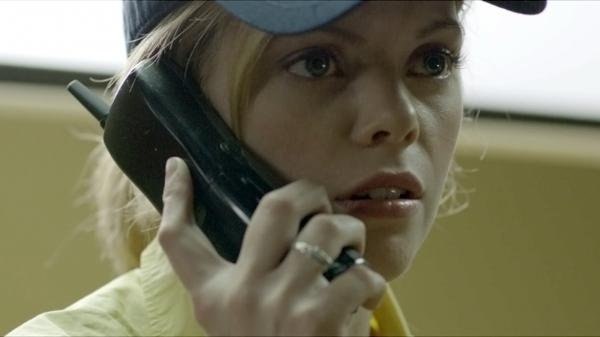 "Fast-food employee Becky (Dreama Walker) finds herself the victim of a cruel ""prank call"" scam in <em>Compliance</em>."