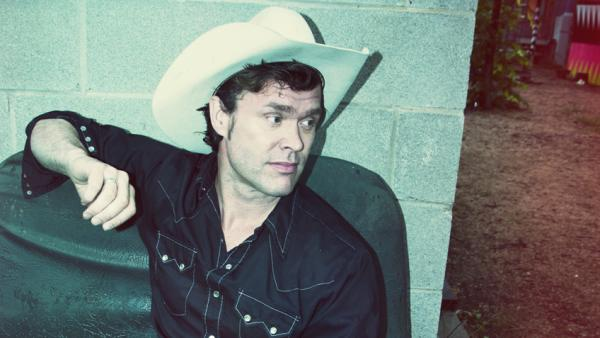 Corb Lund, who wrote most of <em>Cabin Fever,</em> his new album, in a cabin he built himself.