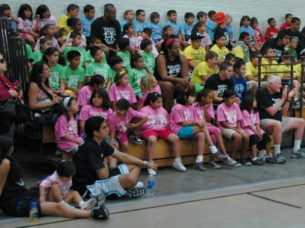 A rainbow of teams at basketball camp.