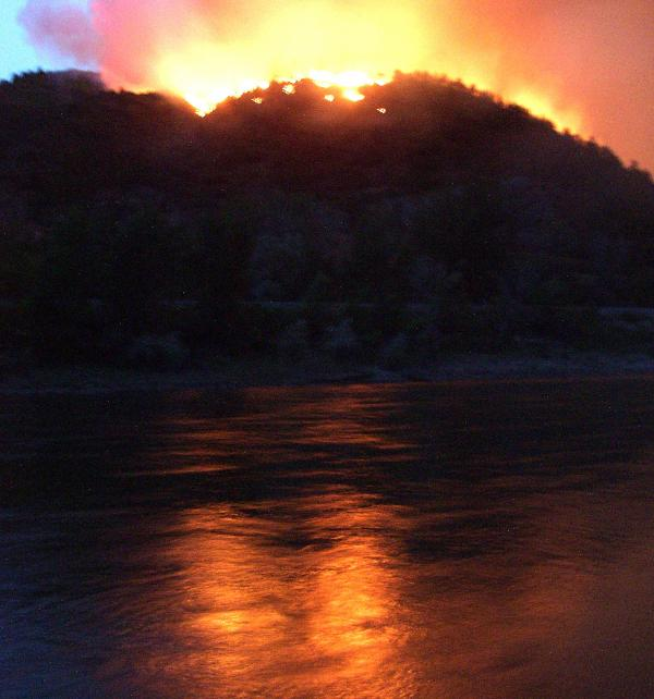 A photograph from June 8, 2002 shows flames from the Hayman wildfire, which burned in in the Rocky Mountains southwest of Denver.