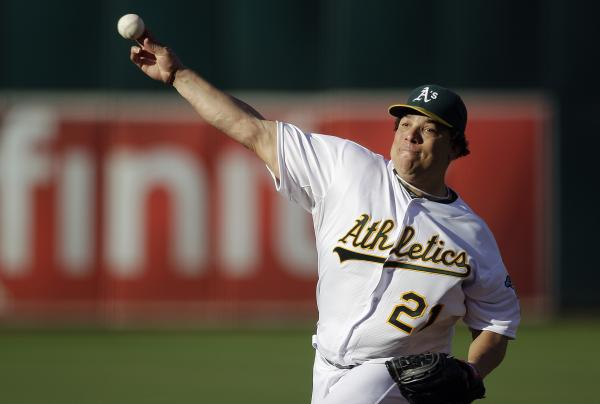 Oakland Athletics pitcher Bartolo Colon works against the Cleveland Indians in the first inning of a baseball game Aug. 18, 2012, in Oakland.