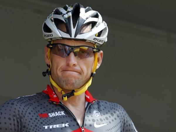 Lance Armstrong grimaces prior to the start of the third stage of the Tour de France cycling race in Wanze, Belgium, on July 6, 2010. Armstrong said Thursday he is finished fighting charges from the U.S. Anti-Doping Agency that he used performance-enhancing drugs during his unprecedented cycling career.