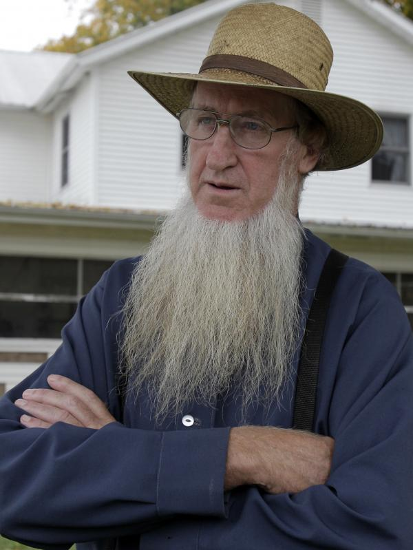 Sam Mullet, in the front yard of his home in Bergholz, Ohio, last year, is one of 16 people charged in beard- and hair- cutting attacks on fellow Amish. Mullet denies being involved in the attacks.
