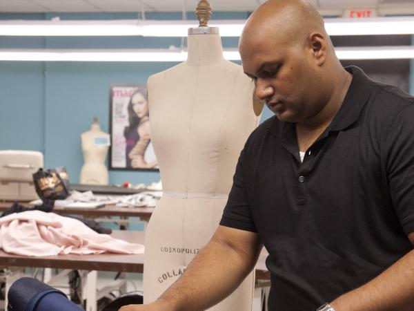 Designer Ven Budhu, seen here on a previous episode, got in big trouble on last night's <em>Project Runway</em>.
