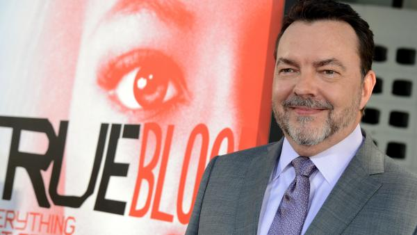 Writer Alan Ball arrives at the premiere of the fifth season of HBO's <em>True Blood</em> in May. Ball is leaving the series at the end of this season.