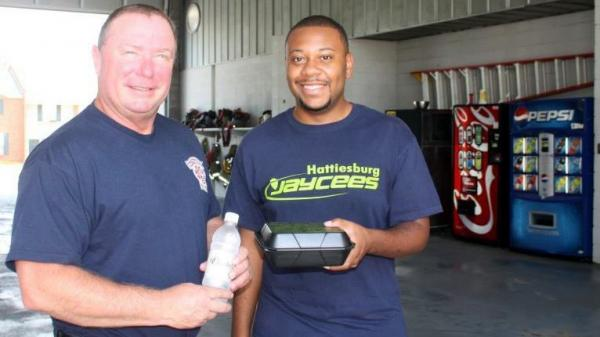 Capt. Michael Davidson of the Hattiesburg Fire Dept. and Jaycee Marquise Slator.
