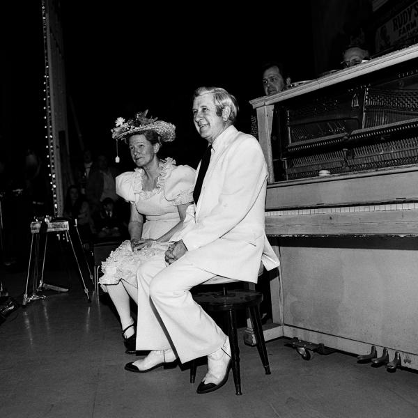 "<em>Minnie Pearl and Pee Wee King,</em> Ryman Auditorium, Nashville, Tenn., 1973. ""Minnie Pearl was the pre-eminent country comedian of her day. With a price tag hanging from her hat, she regaled her fans with tales from Grinder's Switch, a fictional town that influenced Garrison Keillor and his Lake Wobegon."""
