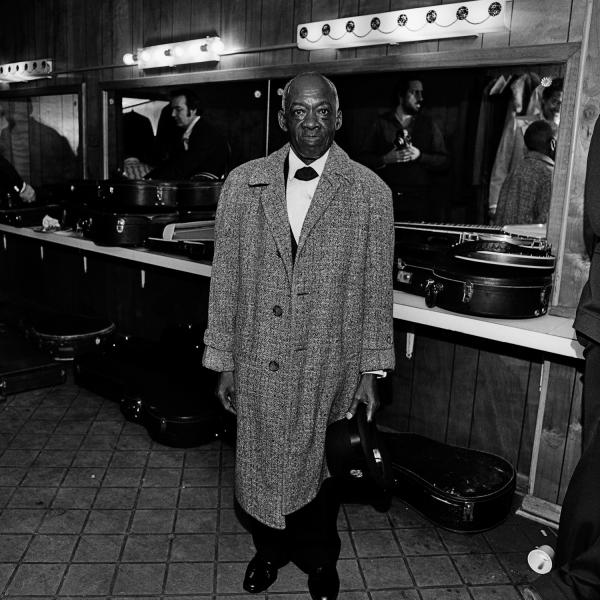 "<em>DeFord Bailey,</em> Grand Ole Opry House, Opryland, Nashville, Tenn., 1974. ""A member of the original Grand Ole Opry cast, DeFord Bailey was discovered in 1926 playing harmonica while operating an elevator. He was fired from the show in 1941 due to changing musical tastes or racism, depending on who's telling the story, and ran a shoeshine business in Nashville until just before his death."""