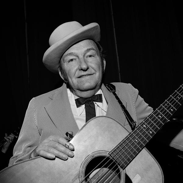 "<em>Lester Flatt,</em> Ryman Auditorium, Nashville, Tenn., 1972. ""Lester Flatt and banjoist Earl Scruggs were the successful Flatt and Scruggs. Flatt's contributions included strong baritone vocals and a signature guitar run, widely imitated even today."""