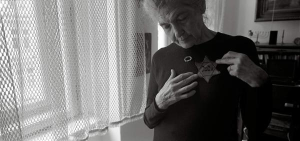 "Andula Lorencova, born in 1927, in her apartment with her original yellow star, Prague, June 2012. While her father was ""trying to procure official Chinese approval for his family to join him, Andula along with her brother and mother were deported to Terezin."""