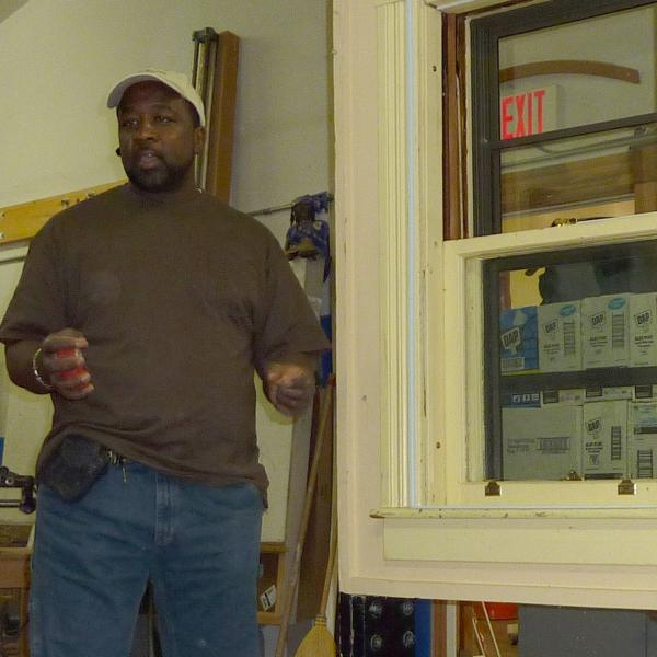 Pernell Jackson teaches a workshop on how to install storm windows.