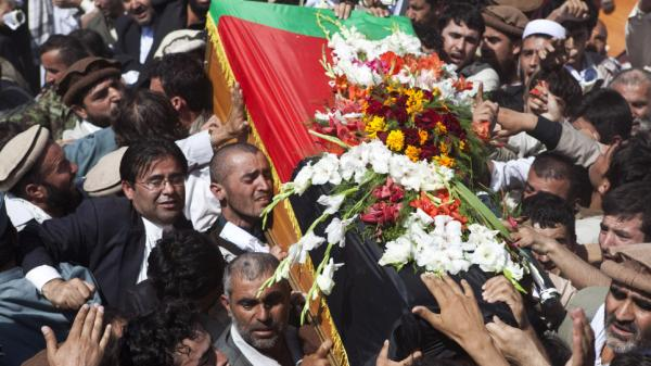 Afghans carry the coffin of Afghanistan High Peace Council head and former President Burhanuddin Rabbani during his burial ceremony in Kabul, Sept. 23. A suicide bomber assassinated Rabbani on Sept. 20, which further complicates the thorny issue of negotiating with the Taliban.