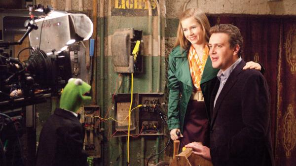<strong>Anchorphibian:</strong> Kermit the Frog does the backstage-chat thing with Amy Adams and Jason Segel in <em>The Muppets.</em>