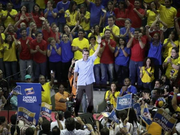 Venezuelan opposition leader Henrique Capriles (center) waves to supporters on Oct. 12, 2011. Capriles is the front-runner in the opposition primary election to pick a candidate to run against President Hugo Chavez. The primary is scheduled for Feb. 12.
