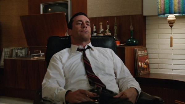 "Don Draper (Jon Hamm) tries to relax as The Beatles' ""Tomorrow Never Knows"" plays on the stereo at the end of the latest episode of <em>Mad Men</em>."