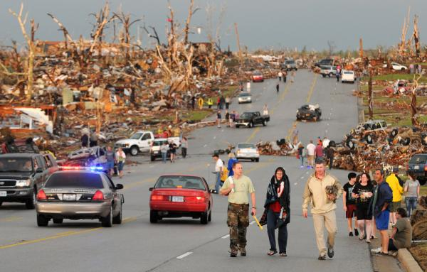 Residents of Joplin walk west on 26th Street near Maiden Lane.