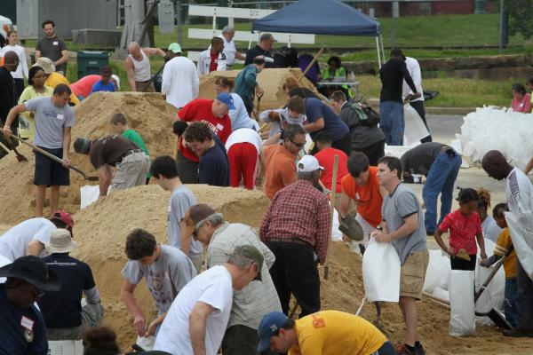 MAY 8: Volunteers in Memphis fill sandbags to help hold back rising floodwater.