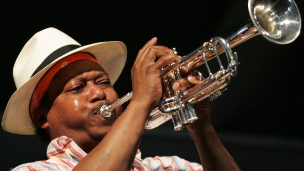 Kermit Ruffins, seen frequently on HBO's <em>Treme</em>, performs around town in New Orleans every week with his band, the BBQ Swingers.