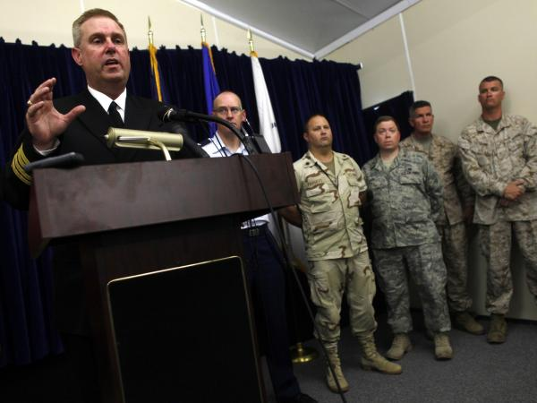 Navy reservist Capt. John Murphy (L), former chief prosecutor of military commissions at Guantanamo Bay, speaks during a press conference in 2009.