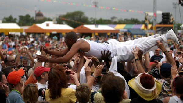 Glen David Andrews, the New Orleans trombonist and singer and regular on HBO's <em>Treme,</em> surfs the crowd at the 2010 New Orleans Jazz & Heritage Festival.