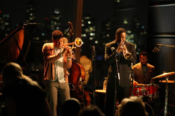 Christian Scott (left, playing himself) and Rob Brown (playing Delmond Lambreaux) perform at Jazz at Lincoln Center in the program <em>Treme</em>.